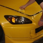 Paint Protection Film applied to hood of Yellow Honda