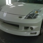 Repaired Hood of White Vehicle