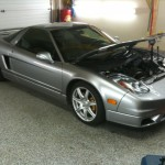 Repaired Silver Sports Car with Hood Open